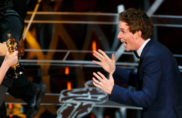 "Actor Redmayne reacts as he takes the stage to accept the Oscar for best actor for his role in ""The Theory of Everything"" during the 87th Academy Awards in Hollywood"